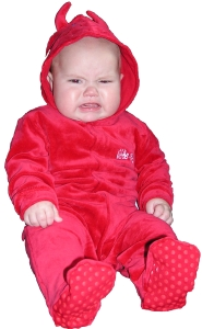 Baby in demon outfit